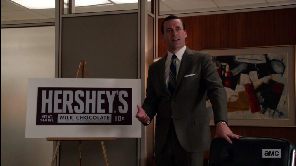 Don Draper giving his most famous new business pitch, just before revealing a shocking secret from his past about a Hershey bar. Photo from AMC.